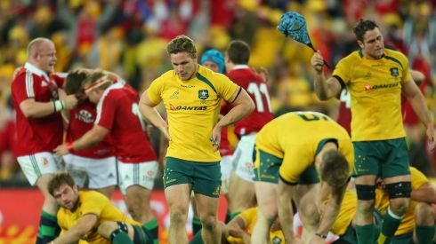 Wallabies captain James Horwill and Michael Hooper look dejected as the Lions celebrate victory at the final whistle. Photograph: Scott Barbour/Getty Images