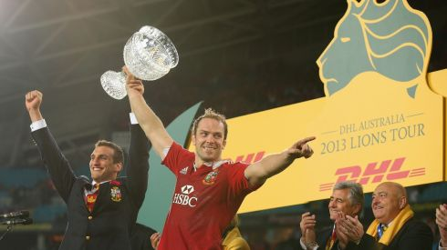Injured Lions captain Sam Warburton and Lions captain Alun Wyn Jones hold the Tom Richards Cup aloft after the Lions victory. Photograph: Cameron Spencer/Getty Images