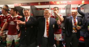 British and Irish Lions head coach Warren Gatland celebrates in the dressing-room after his side secured the series victory over Australia in  Sydney. Photograph:  Billy Stickland/Inpho