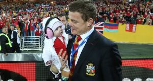 Brian O'Driscoll with his daughter Sadie after the match in Sydney. Photograph: Billy Stickland/Inpho