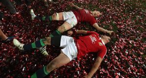 Alun-Wyn Jones and Jamie Roberts roll around in  confetti after their victory over Australia in Sydney on Saturday. Photograph: David Rogers/Getty Images