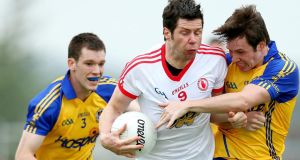 Tyrone's Seán Cavanagh is tacked by Roscommon's Niall Carty and David Keenan at Dr Hyde Park, Roscommon on Saturday. Photograph: James Crombie/Inpho