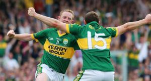 Kerry's Colm Cooper celebrates scoring his goal against Cork. Photograph: Lorraine O'Sullivan/Inpho