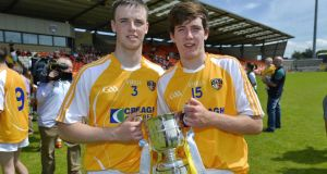 Antrim's Karl O'Kane and Saul McCaughan celebrate with the trophy. Photograph: Inpho
