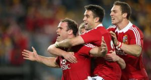 Jamie Roberts of the Lions is mobbed by team-mates Conor Murray and George North  after scoring the Lions' fourth try against Australia during the third and final Test at the  ANZ Stadium  in Sydney, Australia. Photograph: David Rogers/Getty Images)