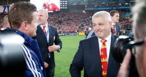 Lions coach Warren Gatland shakes hands with  Brian O'Driscoll following Saturday's third Test victory in Sydney. Photograph: David Gray/Reuters.