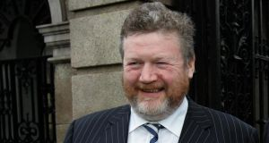 James Reilly: planned savings not realised. Photo: David Sleator