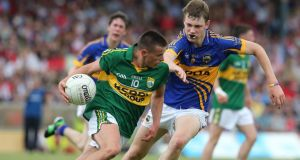 Kerry's Micheal Burns and Liam Casey of Tipperary. Photograph: Lorraine O'Sullivan/Inpho