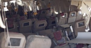 In this handout photo provided by the National Transportation Safety Board, oxygen masks hang from the ceiling in the cabin interior of Asiana Airlines flight 214 following Saturday's crash.  Photograph: NTSB/Getty Images