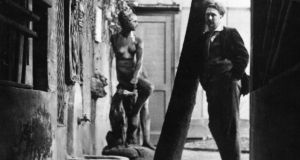 Ezra Pound in the garden outside his Paris studio  in the Latin Quarter of Paris.Photograph:  Topical Press Agency/Getty Images