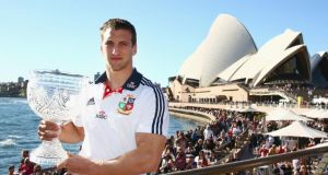 Tour captain Sam Warburton poses with the Tom Richards Cup at the Sydney Opera House. Photograph: Mark Kolbe/Getty Images