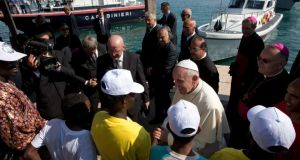 Pope Francis speaks yesterday to migrants on the island of Lampedusa, where he celebrated Mass on a simple altar that sat on a fishing boat. Photograph: Alessandra Tarantino/Reuters