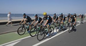 Overall leader Christopher Froome (yellow helmet) rides with his team-mates during training on rest day of the Tour de France.
