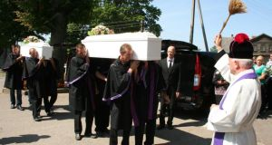 The funeral cortege of Jolanta Lubiene and her daughter Enrika at the village of Gadunavas in Lithuania.