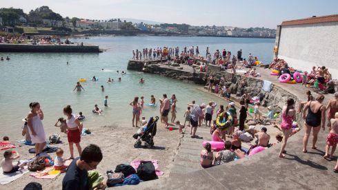Steaming hot: people enjoy the fine weather at Sandycove, Dublin. Photograph: Gareth Chaney/Collins