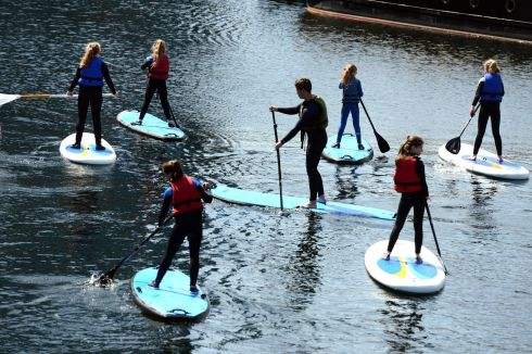 A group from Surfdock  taking a trip on the  Canal Dock area of Dublin , yesterday. Photograph: Cyril Byrne/The Irish Times
