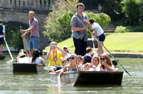 Punts make their way along the river Cam in Cambridge as visitors to the city enjoy the summer sunshine. Photograph: Chris Radburn/PA Wire