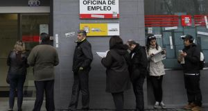 People wait outside an unemployment office in Madrid. The fear of being without work rose in seven of the 12 countries surveyed and was the top concern for 72 per cent of Spanish respondents and 69 per cent of French. Photograph: AP Photo/Andres Kudacki