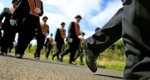 The Orange Order parades along Drumcree road outside Portadown Co Armagh during the annual Orange Order parade to Drumcree Parish Church. Photograph: Julien Behal/PA Wire