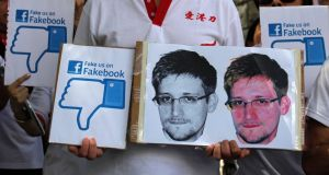 "A demonstrator from the pro-China ""Caring Hong Kong Power"" group protests over claims from former US spy agency contractor Edward Snowden that the National Security Agency hacked computers in the Chinese territory. Photograph: Reuters"