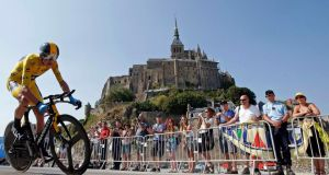 Team Sky rider yellow jersey holder Christopher Froome   cycles past  Mont Saint-Michel during the 32 km individual time trial eleventh stage of the centenary Tour de France. Photograph: Eric Gaillard/Reuters