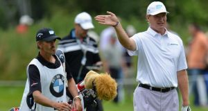 Ernie Els and caddie Colin Byrne during the final round of the BMW International.