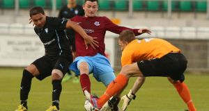 Drogheda's Ryan Brennan (centre) goes close in the first leg  at Tallaght Stadium.