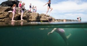 Taking the plunge at the Pollock Holes in Kilkee, Co Clare, was 12-year-old Alex Stewart. Photograph: Alan Place