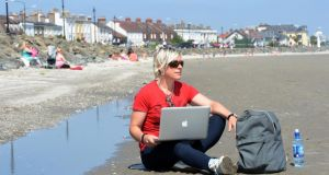 Sarah Francis trying to do a day's work on Sandymount beach . Photograph: Alan Betson