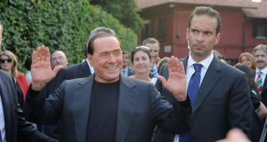 Silvio Berlusconi is greeted by supporters after being found guilty of tax evasion. Photograph:  Pier Marco Tacca/Getty Images
