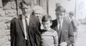 An old photo of the murdered Blaine brothers Tom on left and Jack on right with nephew Paul Dunne  (centre)