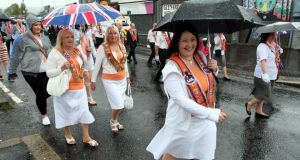Orangewomen walk past the Ardoyne shops in Belfast. Photograph: Paul Faith/PA Wire