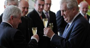 Czech Republic's president Milos Zeman (right) and prime minister Jiri Rusnok toast after the cabinet's inauguration at Prague Castle in Prague on Wednesday. Photograph: David W Cerny/Reuters