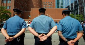 Massachusetts Institute of Technology (MIT) police officers stand outside the federal courthouse. Photograph: Brian Snyder/Reuters
