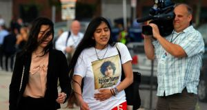 A woman wearing a t-shirt reading 'Dzhokhar Tsarnaev is Innocent' leaves the federal courthouse following the arraignment of the accused Boston Marathon bomber today. Brian Snyder/Reuters