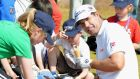 Pádraig Harrington enjoys an ice-cream while signing autographs during the pro-am ahead of the Scottish Open at Castle Stuart Golf Links. Photograph: Getty Images