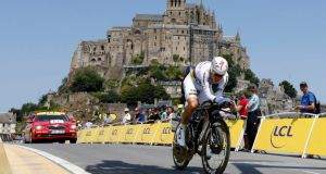 Omega Pharma-Quick Step team rider Tony Martin of Germany cycles past the Mont Saint-Michel during the 32 km individual time trial 11th stage of the Tour de France yesterday. Photograph: Reuters