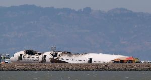 The charred remains of the Asiana Airlines flight 214 sits on the runway at San Francisco International Airport in San Francisco yesterday. Photograph: Jed Jacobsohn/Reuters