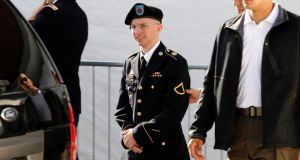 US army Pte Bradley Manning (centre) is escorted in handcuffs as he leaves the courthouse in Fort Meade, Maryland. Pte  Manning is accused of leaking more than 700,000 classified files, videos and diplomatic cables to WikiLeaks.  Photograph: Jose Luis Magana/Files/Reuters