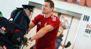 Brian O'Driscoll arrives at Dublin airport yesterday following the British & Irish Lions Tour to Australia. The cost of transport increased by 0.6 per cent last month, driven by rising air fares. Photograph: INPHO/Donall Farmer.