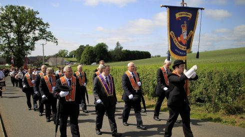 District master of Portadown District Loyal Orange Lodge No 1, Darryl Hewitt (centre), leads the annual Orange Order parade along Drumcree road to Drumcree Parish Church. Photograph: Julien Behal/PA Wire