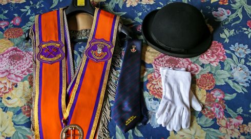 Darryl Hewitt's Orange Order Sash, Bowler hat, tie and parade gloves laid out on his bed ahead of the annual Orange Order parade to Drumcree Parish Church. Photograph: Julien Behal/PA Wire