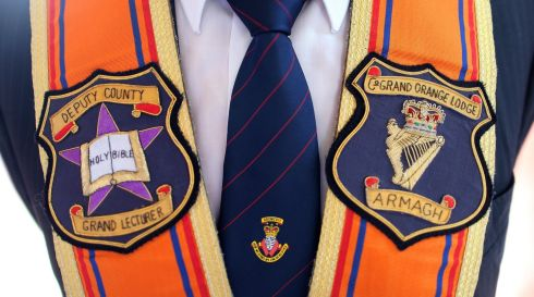 Close-up detail of a Portadown District Loyal Orange Lodge No 1 member's sash. Photograph: Julien Behal/PA Wire