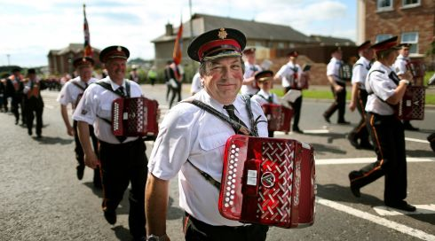 Bandsmen of the Edgarstown Accordion Band from Portadown play through the streets of the town during the annual Orange Order parade to Drumcree Parish Church. Photograph: Julien Behal/PA Wire