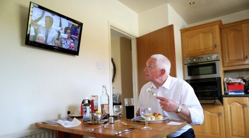 Darryl Hewitt has dinner at home after returning home from the parade. Photograph: Julien Behal/PA Wire