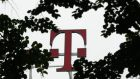 The logo at company headquarters of Deutsche Telekom  in Bonn. Three mobile phone service providers were raided by European Commission regulators in an investigation into abuse of their position regarding mobile internet connectivity. Photograph: Ina Fassbender/Reuters.