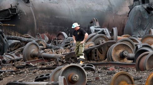 A police officer contemplates the Herculean task of rebuilding Lac-Megantic, Quebec, after the rail disaster which caused massive destruction and an as-yet uncertain number of deaths.  Photograph: Mathieu Belanger/Reuters