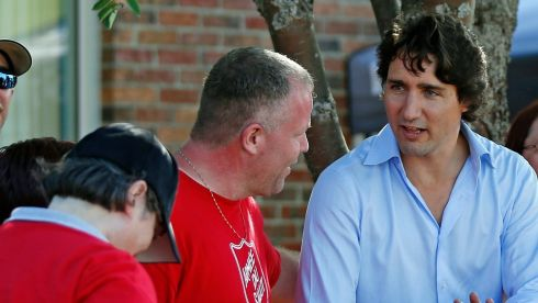 Liberal Party of Canada leader Justin Trudeau speaks with Salvation Army volunteers outside the Polyvalente Montignac, a school used to shelter people who were forced to leave their houses after the Lac-Megantic explosion. Photograph: Mathieu Belanger/Reuters