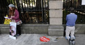 An anti-abortion protester  prays outside the Dail tonight.Photograph: Dave Meehan/The Irish Times