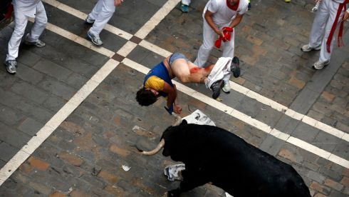 After being gored the runner is tossed in the air. Photograph: Susana Vera/Reuters